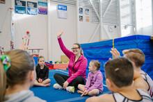 Gym Coach Asking Children Ques...