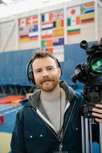 TV Cameraman With Camera In Sp...