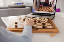 Girl Playing Chess On Video Call