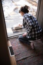 Woman Receiving Takeaway Delivery On Doorstep
