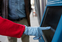 Close Up Gloved Hand Using ATM