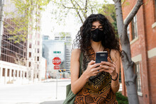 Woman In Face Mask Using Smart...
