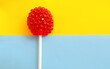 canvas print picture - red berry-shaped lollipop on a yellow-blue background