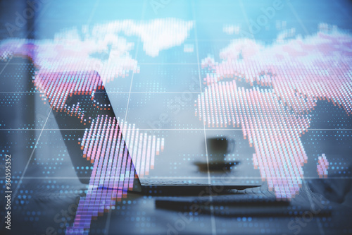 Fotografía Double exposure of business theme icons and work space with computer background