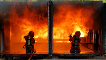 Firefighter Fighting With Flam...