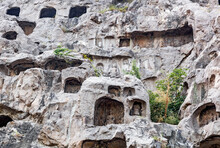 Chinese Buddhist Monument Longmen Grottoes (Dragon's Gate Grottoes, Longmen Caves) On Yi River