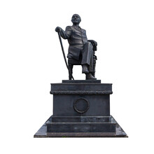 Iron Monument To A Man Sitting On A Throne Holding A Cane In His Hand, The Monument Is Polluted With Pigeons