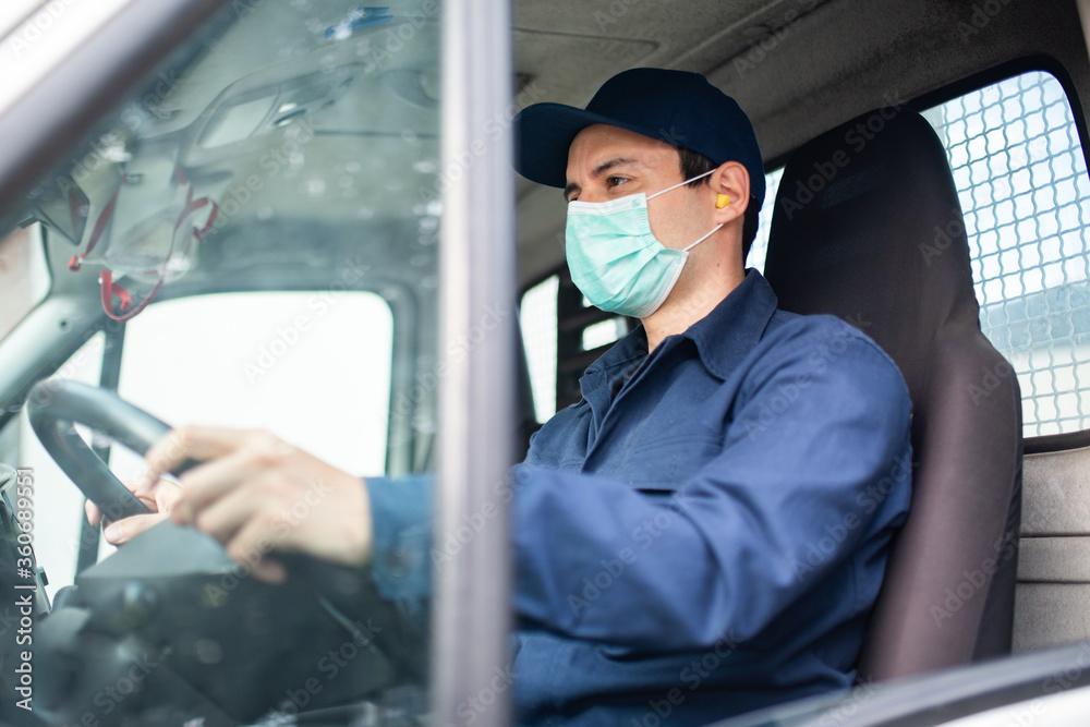 Fototapeta Truck driver giving driving a van during coronavirus pandemic