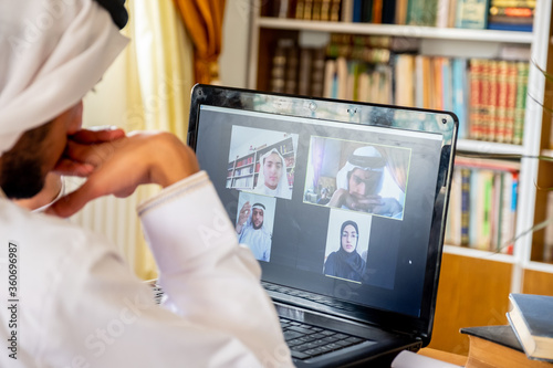 Arabic muslim people using video conference app online Wallpaper Mural