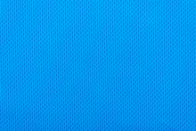 Smooth Surface Of A Blue Polyester Sport T-shirt As Background Or Texture