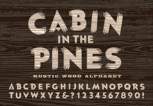 A Rustic Carved Wood Alphabet In The Style Of A Backwoods Cabin Door Or A Forest Service Sign