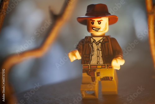NEW YORK USA - JUNE 27 2020: Lego Mini figure depicting a scene from Raiders of the Lost Ark with Indiana Jones running through a jungle