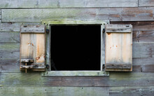 Exterior Wooden Wall Of A Vintage Colonial New England Cabin With An Open Shutter Window And Copy Space
