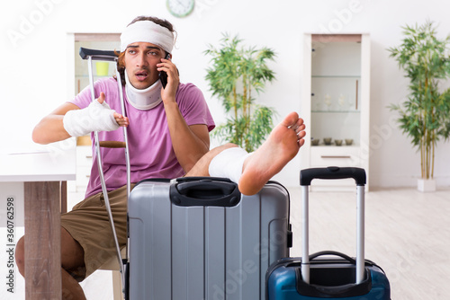 Young injured man preparing for the trip Canvas Print