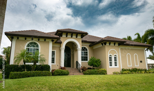 Typical private home at an affluent residential area on Marco Island, Florida. #360765906