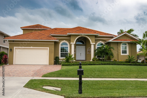 Typical private home at an affluent residential area on Marco Island, Florida. #360765911