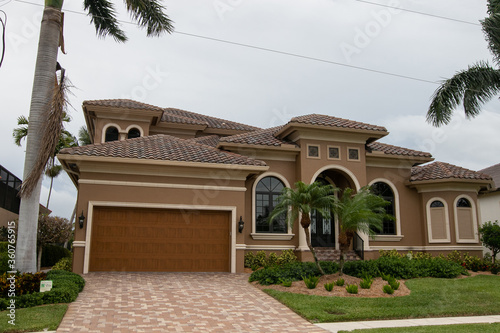 Typical private home at an affluent residential area on Marco Island, Florida. #360765915