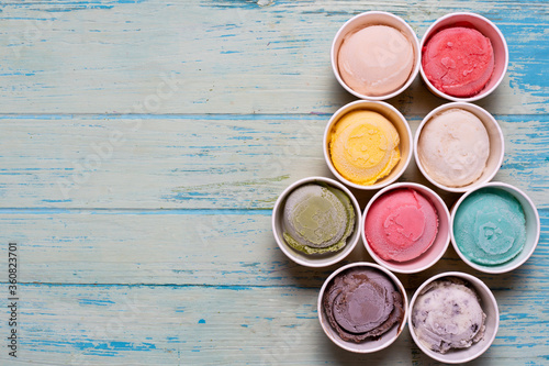 Fototapeta Top view of Ice cream flavors in cup and topping, sweet and dessert food concept obraz
