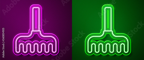Glowing neon line Garden rake icon isolated on purple and green background Wallpaper Mural