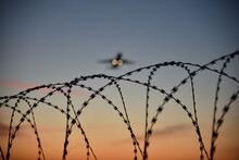 Barbed Wire At Airport With De...
