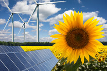 Green Energy Or Renewables Concept On Sun Flower Field  Field Wind Turbines An Solar Panels On A Hot Summer Day
