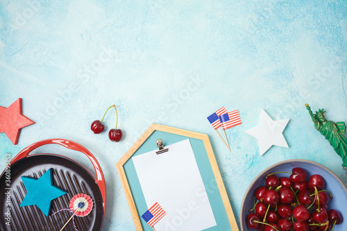 Fototapeta Celebrate at home 4th of July concept with photo frame and patriotic home decor. Top view from above obraz