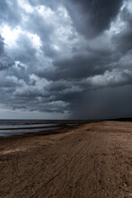 Storm Clouds Over The Beach