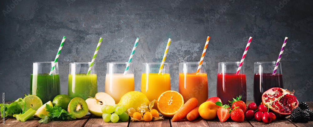 Fototapeta Assortment of fresh fruits and vegetables juices in rainbow colors