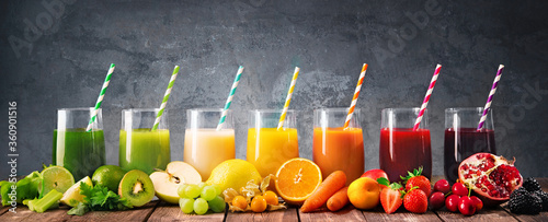 Assortment of fresh fruits and vegetables juices in rainbow colors - 360901516