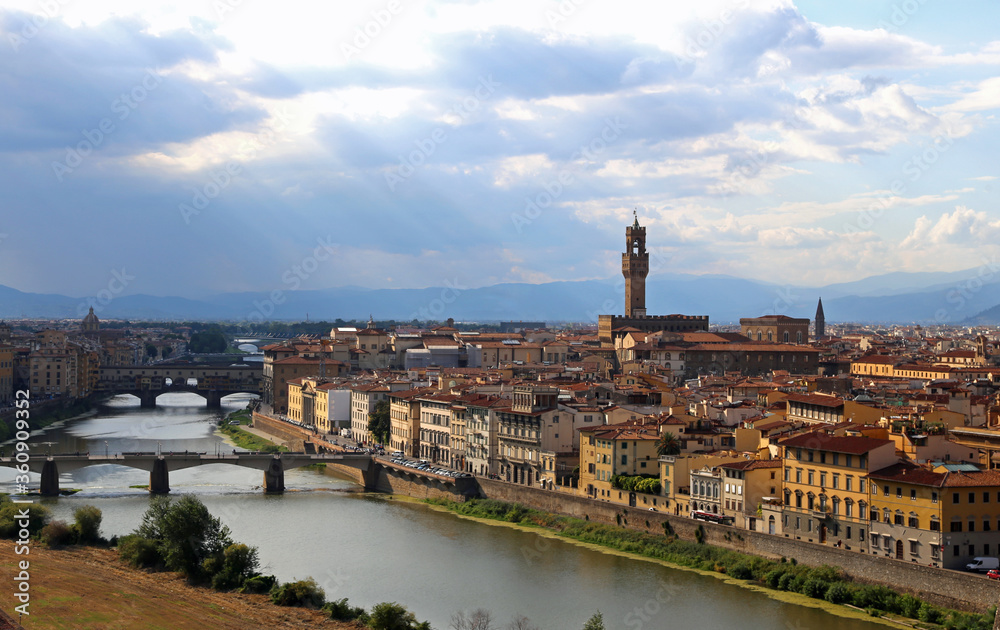 city of Florence with the historic buildings and the tower of Pa