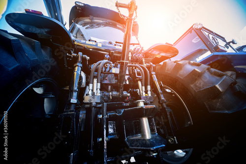 Fototapeta Rear view of modern agricultural tractor. Industrial details. obraz