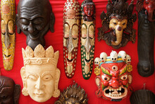 Ethnic And Religious Masks Displayed For Sale Outside A Shop In Kathmandu, Nepal