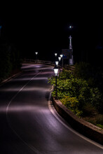 Street By Night Near Sea And Lighthouse