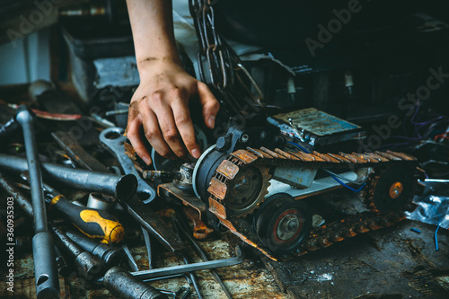 Fototapeta Workbench in the workshop full of old dirty tools and rusty car parts. obraz