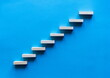 Wooden pegs forming a stairway. Wooden stairs elevate promotion of the business. Business promotion stairs to heaven. stairs to the blue sky. Wooden stairs. Business start up. Promotion and elevation