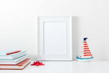 Summer Composition. Travel Concept. White Frame Mockup In Interior With Sea Elements On White Wall Background. Template Frame For Text. Poster Mockup.