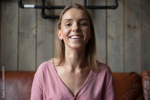 Head shot woman use app modern tech pc screen view provide support to client by distant communication, vlogger record new vlog, girl enjoy informal chat by video call with friends, e-date user concept © fizkes