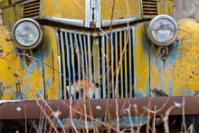 An Old Abandoned Rusty Car Sit...