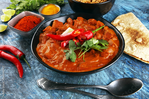 Leinwand Poster Chicken tikka masala spicy curry meat food in pot with rice and naan bread