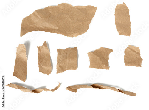 Fényképezés various pieces and twisted brown paper strips and torn pieces isolated on white