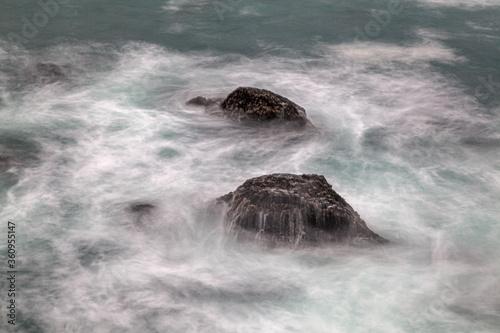 Waves crashing on rocks in Mendocino, California.