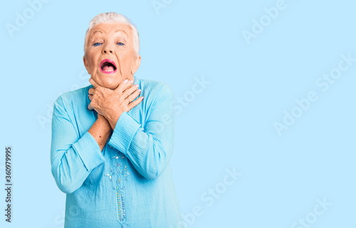 Senior beautiful woman with blue eyes and grey hair wearing summer dress shouting and suffocate because painful strangle Wallpaper Mural