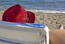 Man In Red Hat On The Beach