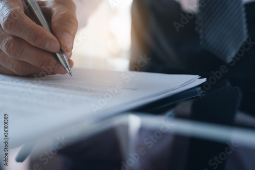 Fototapety, obrazy: Close up of businessman hand signing business contract or document approval process