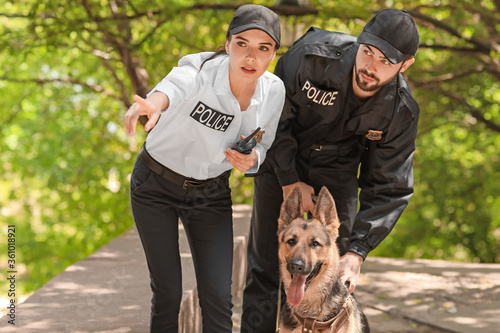 Police officers with dog outdoors Fototapeta