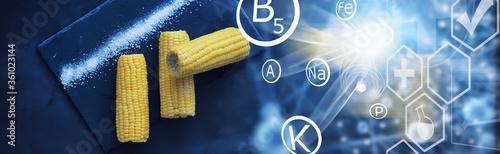 Fototapeta Freshly made fragrant ear of corn with salt. Farm snack of fresh corn. Healthy breakfast and healthy lifestyle concept. obraz