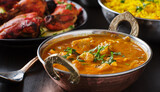 indian butter chicken curry in balti dish on table top