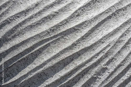 Valokuvatapetti wavy ceramic surface