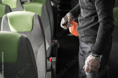 Obraz Sanitizing Procedure Inside Of Intercity Coach Bus. - fototapety do salonu
