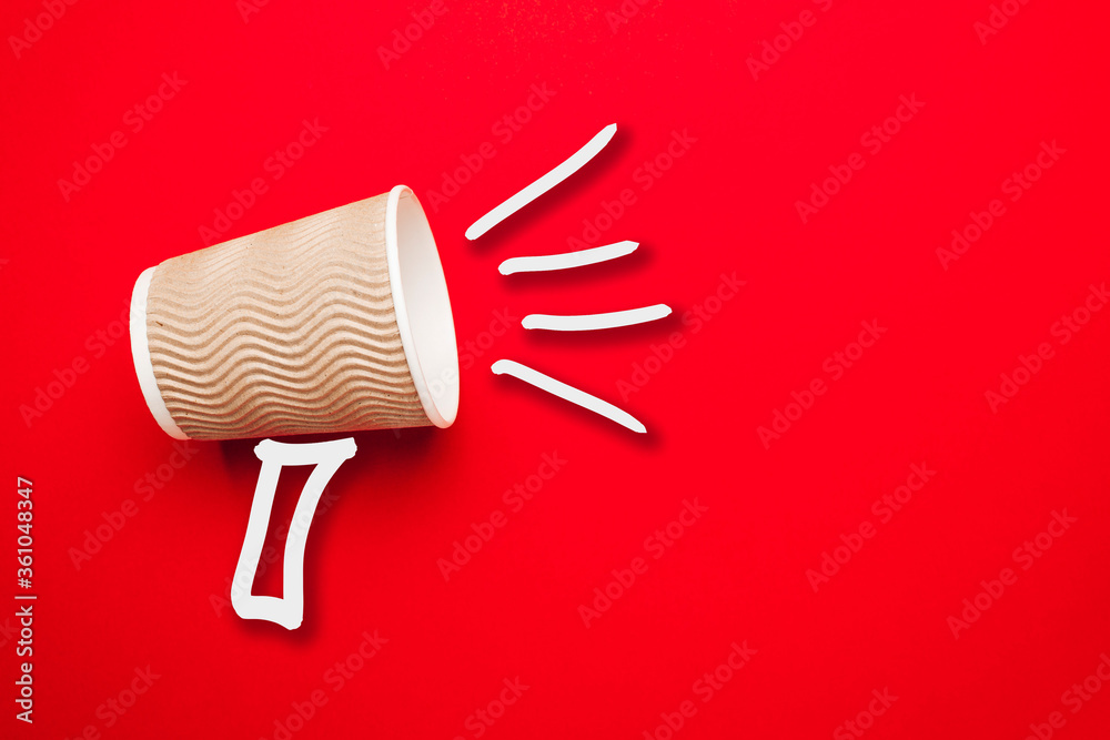 Fototapeta Takeaway coffee in shout concept on red background. Promotion or advertising sale.